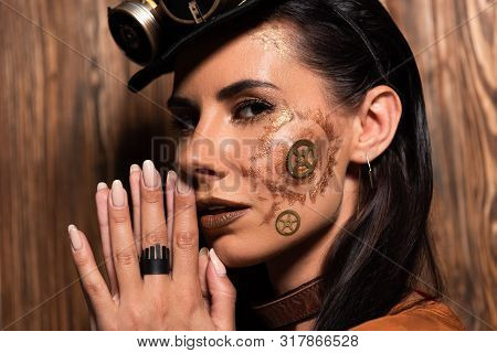 Pensive Steampunk Woman Showing Please Gesture On Wooden
