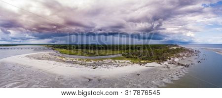 180 degree aerial panorama of dramatic storm front moving over Hunting Island, South Carolina.