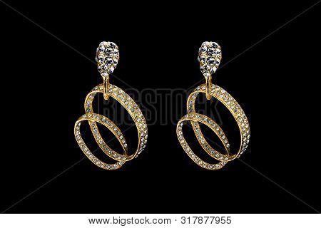 Elegant Gold Earrings With Diamonds On Black Background