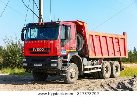 Novyy Urengoy, Russia - August 15, 2019: Red Dump Truck Iveco Amt 6539 In The City Street.
