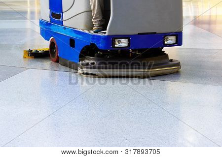 Man Driving Professional Floor Cleaning Machine At Airport Or Railway Station Or Supermarket. Floor