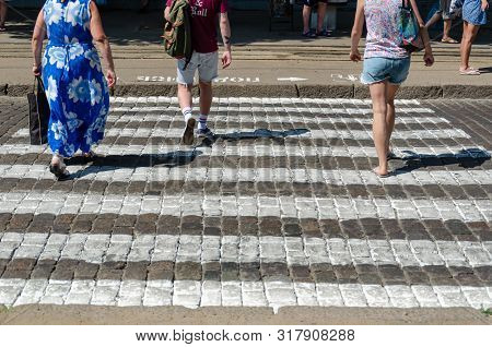 Odessa, Ukraine - July 26, 2019. Frantsuzky Blvd. Feet Of People At A Pedestrian Crossing. People Cr