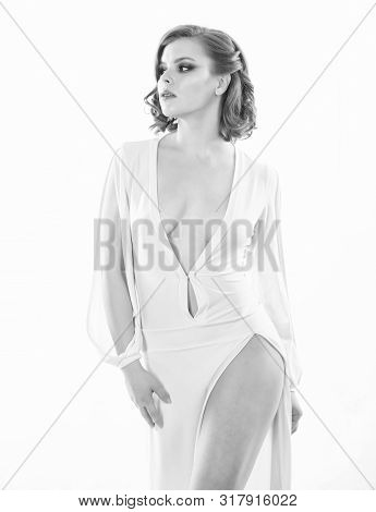Girl attractive vintage model on white background. Sexy vintage fashionable dress. Vintage fashion concept. Woman elegant lady with retro hairstyle and makeup posing in white dress decollete poster