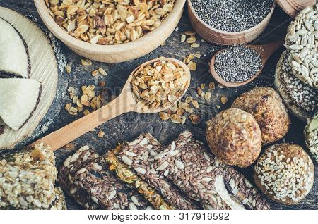 Healthy Snacks. Dietary Food. Sesame Halva. Flakes, Chia Seeds In Two Bowls And Spoons. Kozinaki, Th
