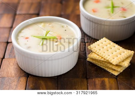 Clam Chowder Bowl With Crackers.