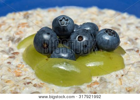 Macro Of Fruit Muesli With Blueberries And Grapes