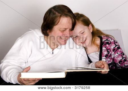 Grandparent Is Reading To Grandchild