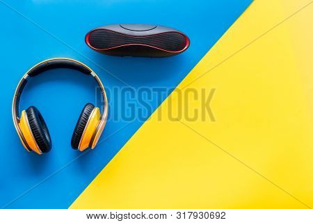 Wireless Speaker And Headphones As Music Gadgets On Yellow And Blue Background Top View Mockup
