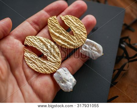 Gold Earrings. Womens Jewelry. Vintage Decoration Background. Beautiful Golden Tones Brooches, Brace