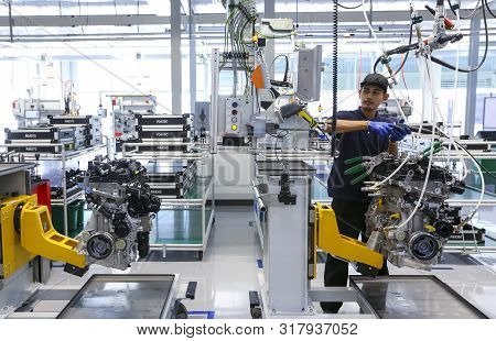 Workers At Engine Assembly Plant