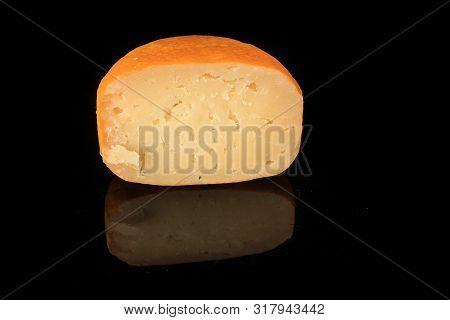 Closeup Half Of Hard Yellow Edam Cheese Head With Holes