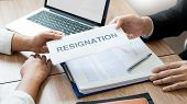 Businessman sending resignation letter to employer boss Including about resignation from positions and vacancies, changing and resigning from work concept for quit or change of job leaving the office, unemployment. poster