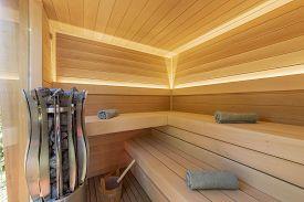 Sauna Room Interior And Sauna Accessories Under Lights