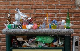 Venice/italy - April 14, 2018: Overloaded Trash Can At The End Of The Day In Venice, Italy. Cruise S
