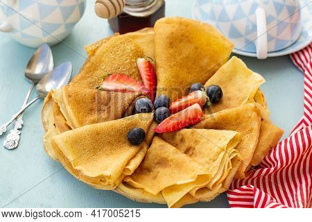Sweet Thin Pancakes Crepes Made Of Buttermilk Served With Berries