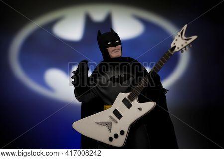APRIL 14 2021: DC Comic Superhero Batman and Bat Signal with electric guitar - Mego Corp action figure