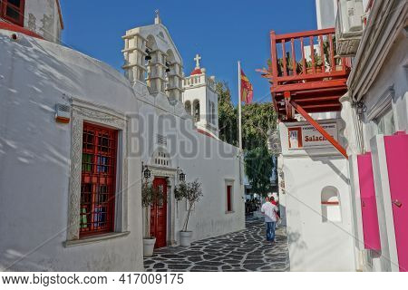 Mykonos, Greece - July 27, 2016 : Picturesque Alley And An Orthodox Church In Mykonos Cyclades Greec