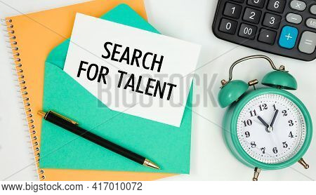 Card On A Postal Envelope With The Text Search For Talent, Clock, Calculator, Pen.