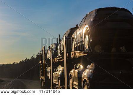 Transportation Of Car On Semi-trailer On Country Highway
