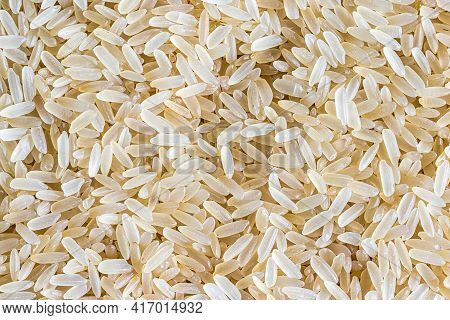 White Rice Grains Background Or Texture. Gluten-free And Healthy Vegeterian Food.