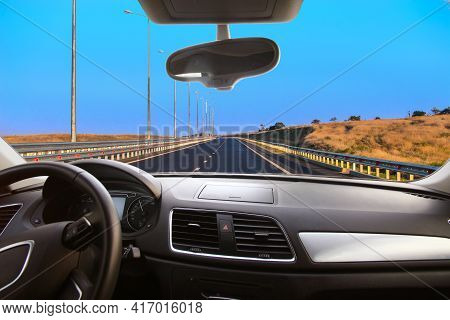 View Of The Suburban Highway From The Car Through The Windshield