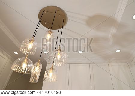 Stylish Pendant Lamp With Light Bulbs On Ceiling In  Modern Room