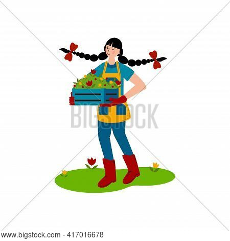 The Girl Carries A Box With Seedlings Of Flowers. Spring Work In The Garden. A Hobby Is Gardening. F