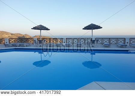 Ios, Greece - July 31, 2014 : Beautiful View On The Aegean Sea From A Swimming Pool In Ios Cyclades