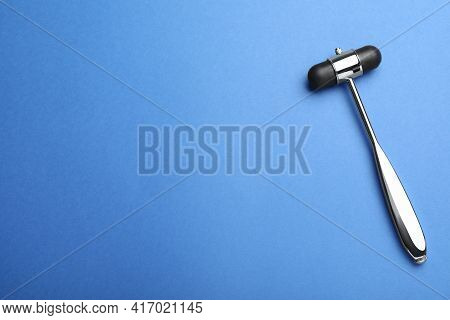 Reflex Hammer On Blue Background, Top View With Space For Text. Nervous System Diagnostic