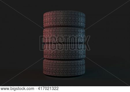 Four tires stacked on top of each other  over dark gray background. Good graphic for a tire store, storage room, tire service. 3d illustration