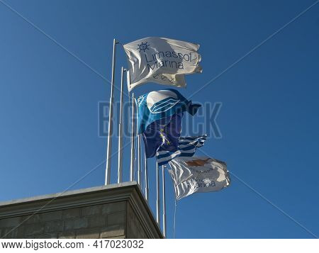 Limassol, Cyprus, April 11th, 2021: Flags With Marina Logo, Blue Flag, European Union Flag, National