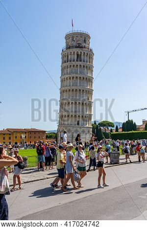 Pisa, Italy - June 25, 2019: Lot Of Tourists Visit Leaning Tower Of Pisa In Summer