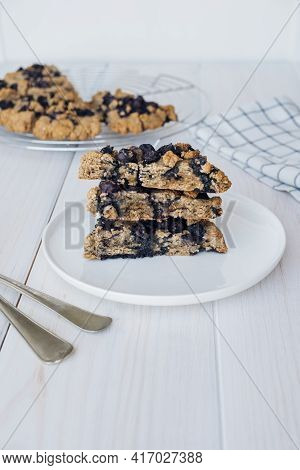 Stack Of Freshly Baked Oat Blueberry Scones On White Plate. Sweet Food With Natural Ingredients. Veg