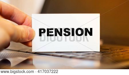 Financial Business Card With The Text Pension. Decrease In Pension Payments. Low Pension Concept.