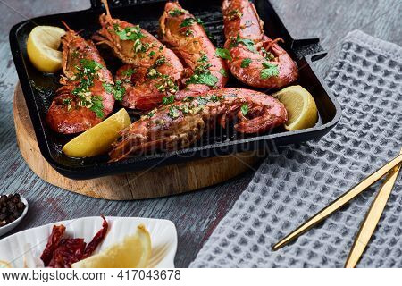 Grilled Large Queen Shrimps With Lemon And On Grill Pan