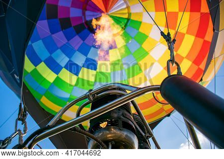 Fire From A Gas Burner In A Hot Air Balloon. Hot Gas Inflates A Bright, Multi-colored Balloon. Botto