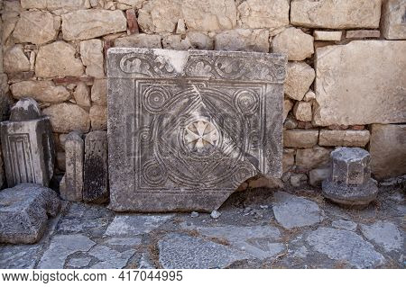 Bas Reliefs On The Ancient Stone. Religious Patterns Carved In Stone. Christian Sign