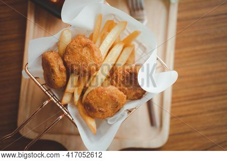 Hot Deep Fried Snacks : Crispy Chicken Nuggets, French Fries Potato In Basket.