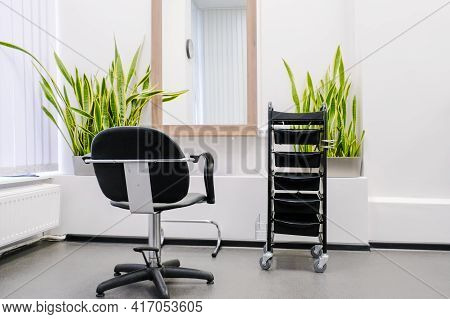 Hairdresser's Workplace. The Interior Of The Barber Shop With Hairdressing Chair And Equipment Is Re