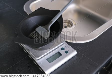Hair Dye Measuring And Mixing Kit. Mixing Bowl And Hair Dye Brush On Electronic Scale. Hair Coloring