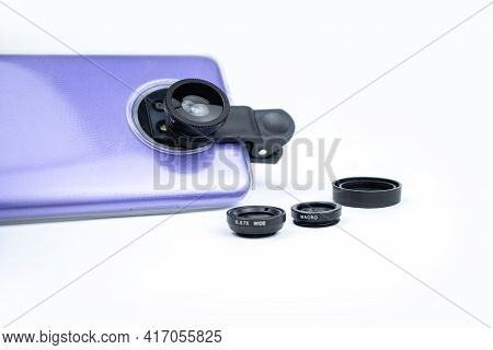 Phone Photo Lens With Clips On White Background. Extra Macro Camera For Smartphone. Set Of Lenses Wi