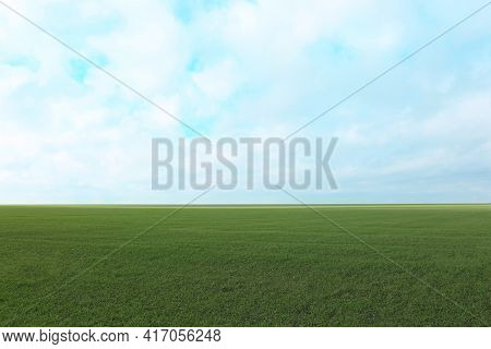 Picturesque View Of Beautiful Countryside Landscape With Green Grass