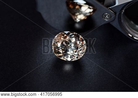 Loose Natural Light Brown Color Oval Faceted Topaz Gemstone On Dark Gray Background With Shades And