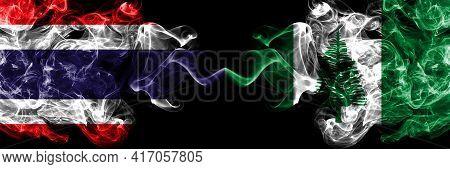 Thailand, Thai Vs Australia, Australian, Norfolk Island Smoky Mystic Flags Placed Side By Side. Thic