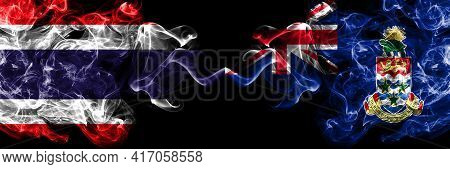 Thailand, Thai Vs British, Britain, Cayman Islands Smoky Mystic Flags Placed Side By Side. Thick Col