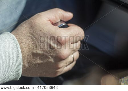 A Man's Hand On The Gearbox In The Car.close-up
