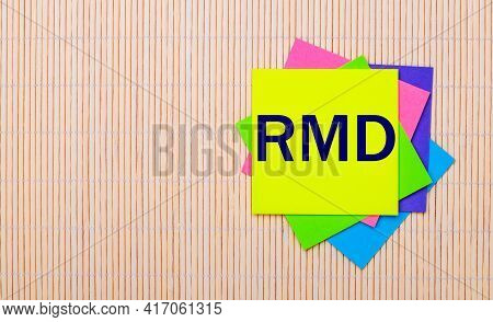 On A Light Wooden Background, Bright Multicolored Stickers With The Text Rmd Required Minimum Distri