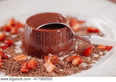 Chocolate Pudding With Fresh Strawberries On A Plate.