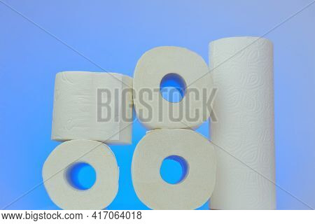 Toilet Paper And Napkins. Hygiene And Cleanliness Concept. Rolls Of Toilet Paper And Napkins On Blue