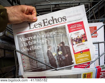 Paris, France - April 11, 2021: Pov Male Hand Buying Les Echo French Newspaper With Breaking News Em